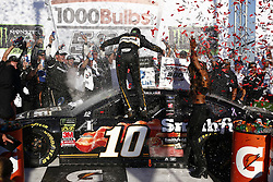 October 14, 2018 - Talladega, Alabama, United States of America - Aric Almirola (10) celebrates in Victory Lane after winning the 1000Bulbs.com 500 at Talladega Superspeedway in Talladega, Alabama. (Credit Image: © Chris Owens Asp Inc/ASP via ZUMA Wire)