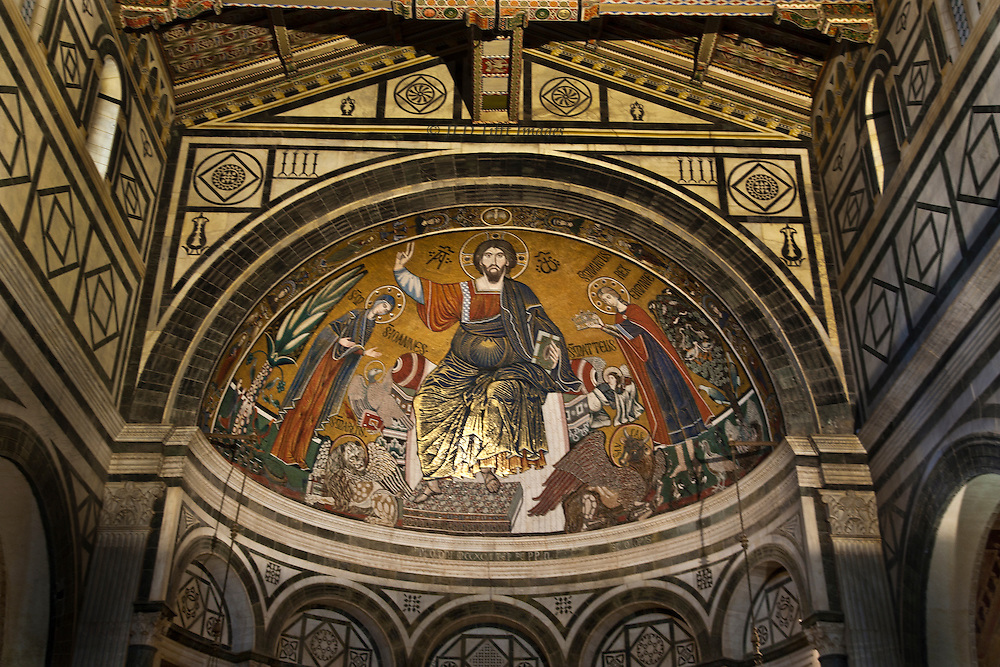 Christ Pantocrator between the Virgin and St. Minias, with Evangelist symbols.  Dated 1260 or 1297, by an unknown artist.  In the apse of the church of San Miniato al Monte, Florence.