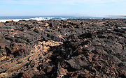 Lava flow volcanic rocks on beach near Majanicho on north coast of Fuerteventura, Canary Islands, Spain