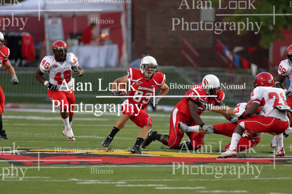 19 September 2009: Jake Knecht breaks the line of scrimmage as Charles Dennis puts Daniel Becker to the ground in a game which the Austin Peay Governors were defeated 38-7 by the Illinois State Redbirds at Hancock Stadium on campus of Illinois State University in Normal Illinois