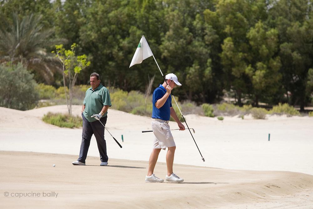Abu Dhabi, United Arab Emirates (UAE). .March 20th 2009..Al Ghazal Golf Club..36th Abu Dhabi Men's Open Championship..Hany Abdelnour (left), Mathew Turner (right).