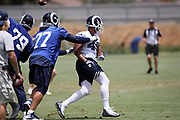 Los Angeles Rams offensive tackle Andrew Whitworth (77) blocks as Los Angeles Rams rookie defensive end Trevon Young (49), a 6th round pick in the 2018 NFL draft, chases the action during the Los Angeles Rams NFL football camp on Monday, June 4, 2018 in Thousand Oaks, Calif. (©Paul Anthony Spinelli)