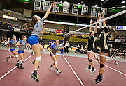 Pleasant Grove's Katherine Biggs (14) makes a slam during the Utah State High School Volleyball 5A championship match between Pleasant Grove and Lone Peak in the UCCU in Orem, Saturday, Nov. 3, 2012.