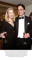 COUNT & COUNTESS ALLESANDRO GUERRINI-MARALDI at a dinner in London on 17th May 2001.	OOH 140