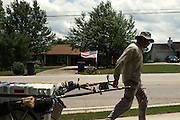 """DACULA, GA – JUNE 6, 2014: Karl Bushby carries his belongings in a custom-made cart called """"The Beast"""" as he passes through an Atlanta suburb. In 1998, when Bushby began his walk, he had $800 in his pocket. """"I'm just an average guy,"""" Bushby said. """"I'm less than average, and I'm showing that anybody can do it.""""<br /> <br /> Karl Bushby is trying to complete the longest walk in history. Unless the Russians stop him. As a 45 year-old Brit, Bushby has been traveling around the world on foot since 1998. In the most recent leg of his journey, Bushby is walking to Washington, D.C. to petition the Russian Embassy to lift a visa ban that prohibited him from continuing his hike through Russia."""