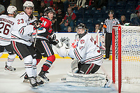 KELOWNA, CANADA - NOVEMBER 9:  Brady Gaudet #23 and Bolton Pouliot #31 of the Red Deer Rebels  and Rourke Chartier #14 of the Kelowna Rockets watch the puck at the Kelowna Rockets on November 9, 2012 at Prospera Place in Kelowna, British Columbia, Canada (Photo by Marissa Baecker/Shoot the Breeze) *** Local Caption ***