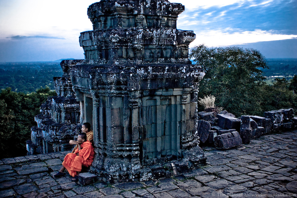 Monks sit atop Phnom Bakheng near Angkor Wat in Siem Reap, Cambodia.