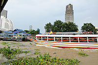 Public transportation on the Chao Phraya River at Taskin Station, Bangkok Thailand