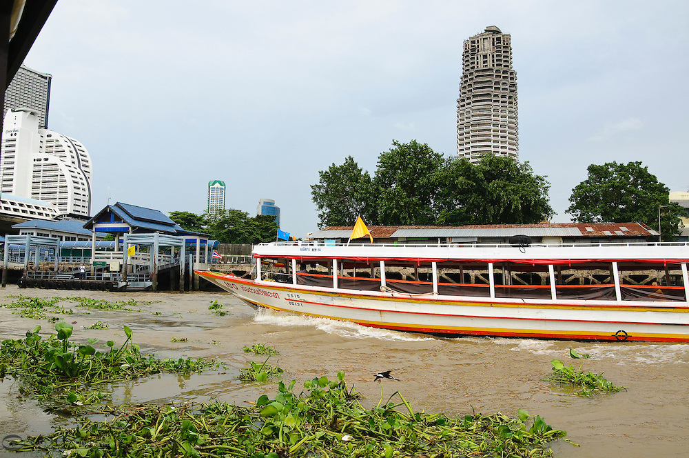 Public transportation on the Chao Phraya River at Taskin Station, Bangkok Thailand
