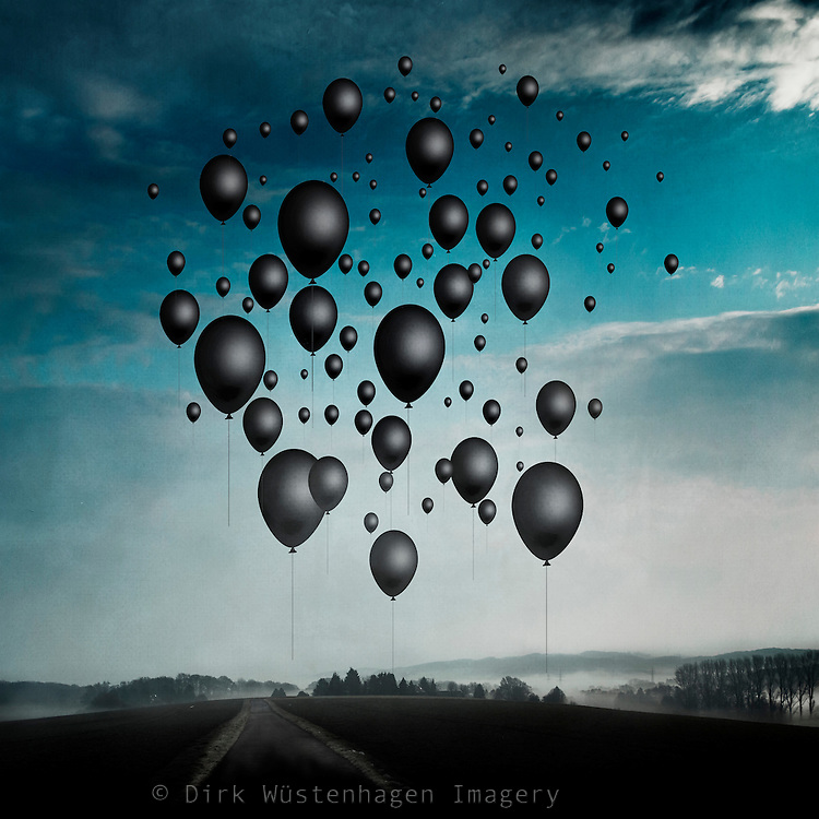 Surreal landscape with black balloons<br />