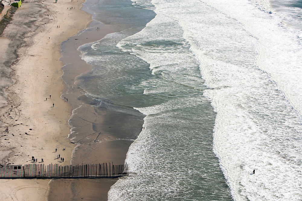 "The US/Mexico border at the southern most point where it enters the Pacific Ocean at Imperial Beach, CA. For more images, search for ""immigration by air and sea"". Please contact Todd Bigelow directly with your licensing requests."