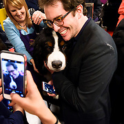 "February 16, 2016 - New York, NY : David Fish, in suit, grabs a photo with ""Jackson"" (Avatar's Smooth Criminal), a Burnese Mountain Dog, at the 140th Annual Westminster Kennel Club Dog Show at Madison Square Garden in Manhattan on Tuesday evening, February 16, 2016. CREDIT: Karsten Moran for The New York Times"
