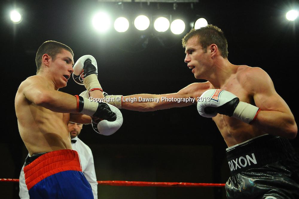 Robert  Dixon (black shots) defeats Marek Laskowski at Rainton Meadows Arena, Houghton Le Spring, Tyne & Wear, UK. 15th February 2013. Frank Maloney Promotions. © Leigh Dawney 2013