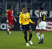 Photo: Chris Ratcliffe.<br />Juventus v Arsenal. UEFA Champions League. Quarter-Finals. 05/04/2006. <br />Thierry Henry celebrates with Emerson and Gianluigi Buffon in the background