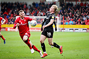 Walsall FC defender Nicky Devlin (6) keeps Barnsley defender Ben Williams (28) at bay during the EFL Sky Bet League 1 match between Walsall and Barnsley at the Banks's Stadium, Walsall, England on 23 March 2019.
