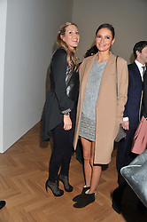 Left to right, LAURA BARDIGER and SASHA VOLKOVA at a party to celebrate the launch of the new gallery Pace at 6 Burlington Gardens, London on 3rd October 2012.