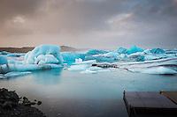 Jökulsárlón glacial lagoon, southeast Iceland. Moody sky over blue icebergs.