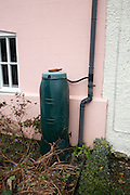 Water butt connected to drainpipe