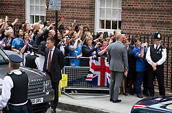 © London News Pictures. 23/07/2013.  Staff from St Mary's Hospital watch Prince Charles arriving at St Mary's Hospital to visit Prince William and  The Duchess of Cambridge who gave birth to a baby boy yesterday. Photo credit: Ben Cawthra/LNP