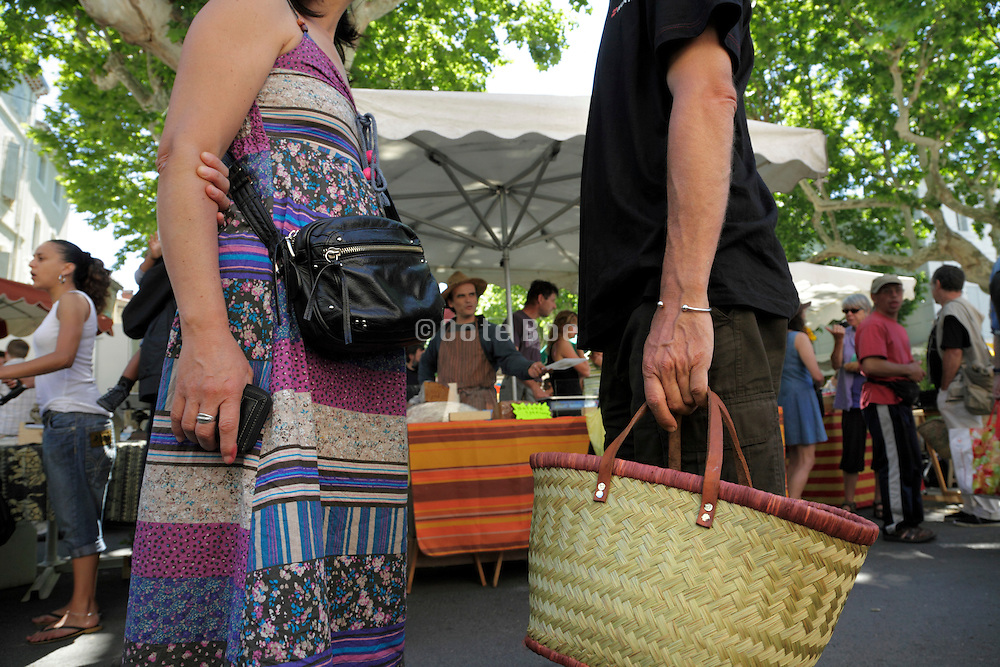 meeting up on a crowded outdoors farmers market France