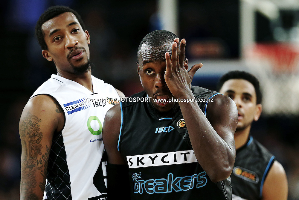 Cedric Jackson of the Breakers reacts as Jordan McRae of Melbourne United looks on. 2014/15 ANBL, SkyCity Breakers vs Melbourne United, Vector Arena, Auckland, New Zealand. Friday 21 November 2014. Photo: Anthony Au-Yeung / photosport.co.nz