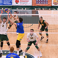 2nd year middle blocker Conal McAinsh (2) of the Regina Cougars in action during Men's Volleyball home game on February 3 at Centre for Kinesiology, Health and Sport. Credit: Arthur Ward/Arthur Images