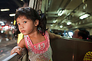 Mar 22, 2009 -- A girl on the train from Samut Sakhon to Thonburi. The Mahachai Rail Line is a commuter line that runs from the Wong Wian Yai train station in the Thonburi section of Bangkok to the fishing port and market town of Samut Sakhon, which used to be known as Mahachai. A second line from Baan Laem to Samut Songkhram, another fishing port south of Samut Sakhon. Each stretch of the line takes about an hour.    Photo by Jack Kurtz