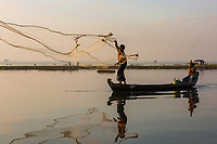 U BEIN BRIDGE, MYANMAR - NOVEMBER 28, 2016 : fishermen fishing on the Taungthaman Lake Amarapura  Mandalay state Myanmar (Burma)