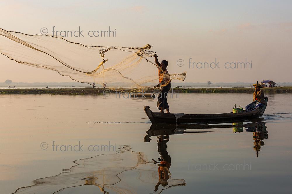 U BEIN BRIDGE, MYANMAR - NOVEMBER 28, 2016 : fishermen fishing on the Taungthaman Lake Amarapura  Mandalay state Myanmar (Burma)