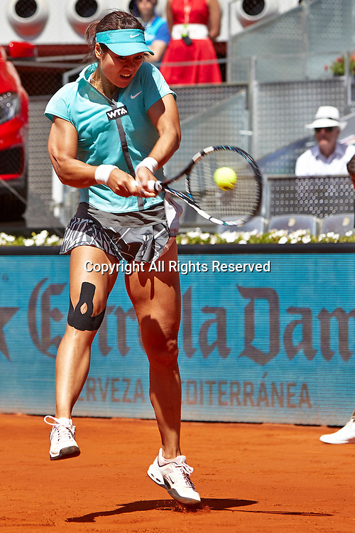 06.05.2014 Madrid, Spain. Na Li of China plays a double handed backhand  during the game with on day 3 of the Madrid Open from La Caja Magica.