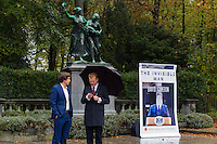 Brussels Belgium 15 october 2015. While an extra EU SUmmit on migration is going on 300 meters away, protesters gathered in the Park Cinquantenaire. The invisable Man, David Cameron, does it say in this poster of the BREXIT movement. Two representatives  stand in the rain. vote leave take control says the banner.
