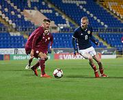 10th November 2017, McDiarmid Park, Perth, Scotland, UEFA Under-21 European Championships Qualifier, Scotland versus Latvia; Scotland's Oliver McBurnie takes on Latvia's Antonijs Cernomordijs