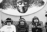 Three men sit on couch wearing virtual reality goggles. Glastonbury 1993