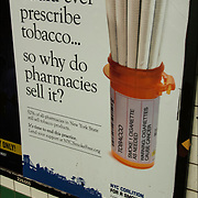"Public Service Anti-Smoking Advertisement  in subway ""No Doctor Would Prescribe Tobacco, So Why Do Pharmacies Sell It? It's time to end this practice"""