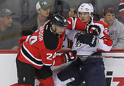 April 24, 2012; Newark, NJ, USA; New Jersey Devils defenseman Bryce Salvador (24) hits Florida Panthers center Tomas Kopecky (82) during the first period of game six of the 2012 Eastern Conference quarterfinals at the Prudential Center.