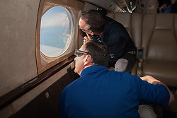 Acting NASA administrator Robert Lightfoot, foreground, and NASA Associate Administrator for the Science Mission DirectorateThomas Zurbuchen view the solar eclipse Monday, August 21, 2017, from onboard a NASA Armstrong Flight Research Center's Gulfstream III 35,000 feet above the Oregon Coast. A total solar eclipse swept across a narrow portion of the contiguous United States from Lincoln Beach, Oregon to Charleston, South Carolina. Photo Credit: (NASA/Carla Thomas)