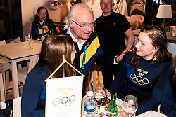 February 23, 2018 - Pyeongchang, SOUTH KOREA - 180222 Linn Persson of Sweden meet H.M Carl XVI Gustaf, King of Sweden at Sweden Arena after they won silver in the WomenÃ•s Biathlon Relay during day thirteen of the 2018 Winter Olympics on February 22, 2018 in Pyeongchang..Photo: Petter Arvidson / BILDBYRN / kod PA / 91995 (Credit Image: © Petter Arvidson/Bildbyran via ZUMA Press)
