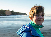 Lorel Dederer pauses during a New Year's day walk along the beach at Cox Bay near Tofino, B.C. Dederer tries to always walk the length of the beach she is on and rarely walks away without a beach-combed treasure or two.