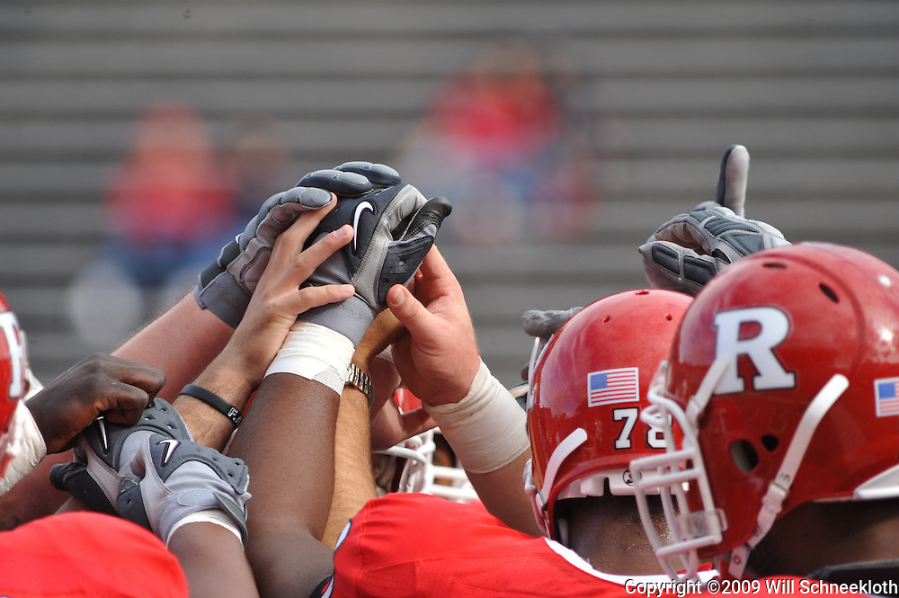 Oct 10, 2009; Piscataway, NJ, USA; Rutgers offensive linemen come together before first half NCAA college football action between Rutgers and Texas Southern at Rutgers Stadium.