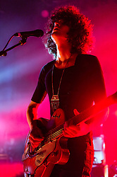 © Licensed to London News Pictures. 08/03/2014. London, UK.   Temples performing live at Shepherds Bush Empire. In this picture - James Edward Bagshaw.  Temples are an English psychedelic rock band consisting of members James Edward Bagshaw (singer/guitarist), bassist Thomas Edison Warmsley (bass), Sam Toms (drums) and Adam Smith (keyboards/guitar/vocals).   Photo credit : Richard Isaac/LNP