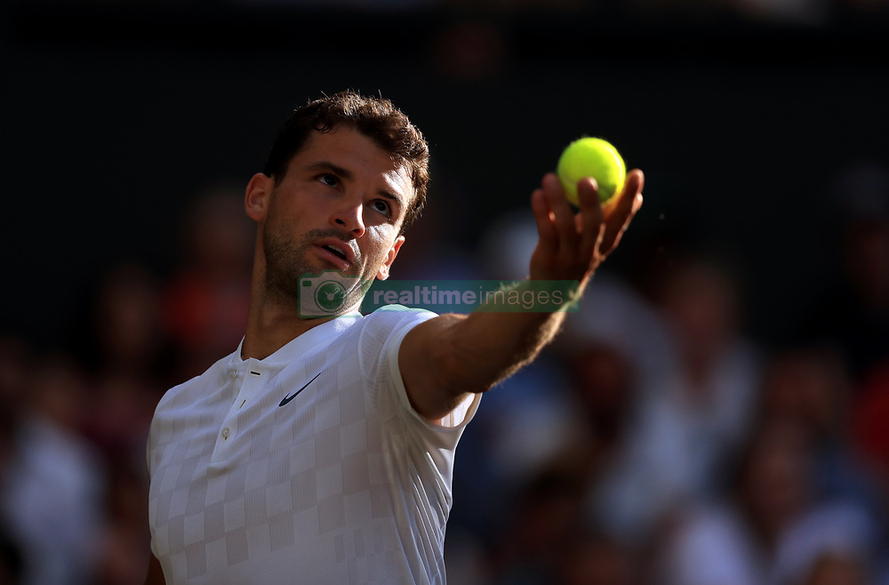 Grigor Dimitrov in action against Roger Federer on day seven of the Wimbledon Championships at The All England Lawn Tennis and Croquet Club, Wimbledon.