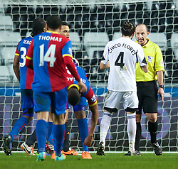 SWANSEA, WALES - Sunday, March 2, 2014: Swansea City's Chico Flores is shown a red card and sent off by referee Mike Dean against Crystal Palace during the Premiership match at the Liberty Stadium. (Pic by David Rawcliffe/Propaganda)