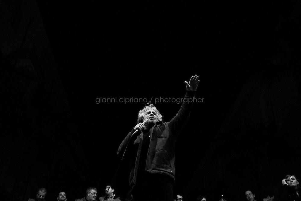Taranto, Italy - 19 January 2013:  Comic Beppe Grillo, leader of the 5 Stars Movement in Taranto, Italy, on January 19th 2013.ROME, ITALY - 19 JANUARY 2013: Beppe Grillo, a comedian and leader of the 5 Stars Movement (M5S, Movimento 5 Stelle) rallies in Taranto, Apulia, on January 19 2013. Grillo, whom presents itself as a &quot;non-politician&quot;, and the 5 Stars Movement as &quot;not a party&quot;. Grillo has been running a mostly internet-based political campaign through the party's blog and the local groups that have emerged from it. The movement has a strong anti-politics agenda: &quot;All political parties are crooked and they all need to go&quot;, Grillo says.<br /> <br /> <br /> A general election to determine the 630 members of the Chamber of Deputies and the 315 elective members of the Senate, the two houses of the Italian parliament, will take place on 24&ndash;25 February 2013. The main candidates running for Prime Minister are Pierluigi Bersani (leader of the centre-left coalition &quot;Italy. Common Good&quot;), former PM Mario Monti (leader of the centrist coalition &quot;With Monti for Italy&quot;) and former PM Silvio Berlusconi (leader of the centre-right coalition).<br /> <br /> ###<br /> <br /> ROMA, ITALIA - 24 GENNAIO 2013: <br /> <br /> a Roma, il 24 gennaio 2013.<br /> <br /> Le elezioni politiche italiane del 2013 per il rinnovo dei due rami del Parlamento italiano &ndash; la Camera dei deputati e il Senato della Repubblica &ndash; si terranno domenica 24 e luned&igrave; 25 febbraio 2013 a seguito dello scioglimento anticipato delle Camere avvenuto il 22 dicembre 2012, quattro mesi prima della conclusione naturale della XVI Legislatura. I principali candidate per la Presidenza del Consiglio sono Pierluigi Bersani (leader della coalizione di centro-sinistra &quot;Italia. Bene Comune&quot;), il premier uscente Mario Monti (leader della coalizione di centro &quot;Con Monti per l'Italia&quot;) e l'ex-premier Silvio Berlusconi (leader della coa