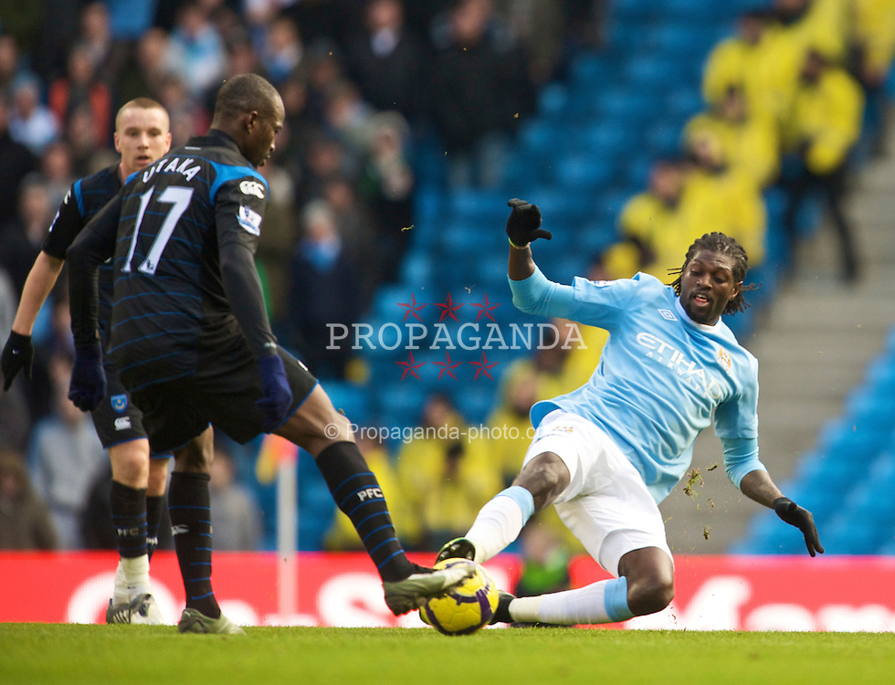 MANCHESTER, ENGLAND - Sunday, January 31, 2010: Manchester City's Emmanuel Adebayor and Portsmouth's John Utaka during the Premiership match at the City of Manchester Stadium. (Photo by David Rawcliffe/Propaganda)