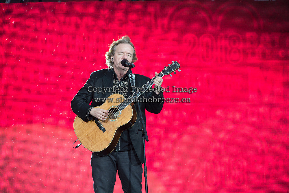REGINA, SK - MAY 17: Jack Semple plays his guitar in the rain during the opening ceremonies of the 2018 MasterCard Memorial Cup at Mosaic Stadium on May 17, 2018 in Regina, Canada. (Photo by Marissa Baecker/Shoot the Breeze)