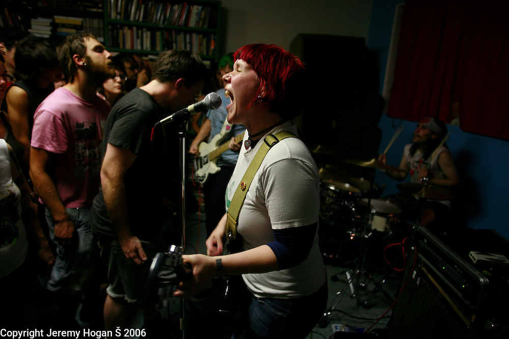 """""""This is my fist,"""" a punk band, performs at Box Car Books during the 2006 Plan-it-X Festival in Bloomington, Indiana."""