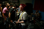 """This is my fist,"" a punk band, performs at Box Car Books during the 2006 Plan-it-X Festival in Bloomington, Indiana."