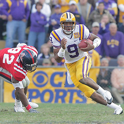 22 November 2008: LSU quarterback Jordan Jefferson (9) runs away for Mississippi defensive end Marcus Tillman (92) during the Ole Miss Rebels 31-13 victory over the LSU Tigers at Tiger Stadium in Baton Rouge, LA.