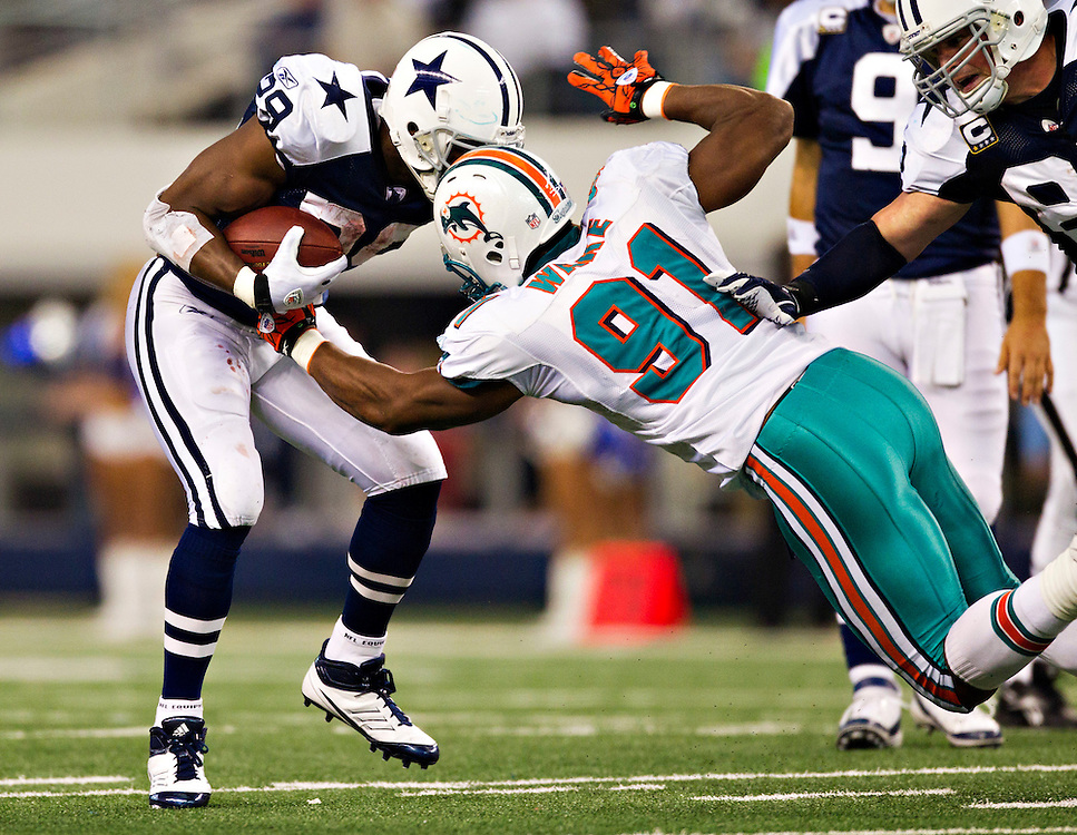 ARLINGTON, TX - NOVEMBER 24:   DeMarco Murray #29 of the Dallas Cowboys is hit by Cameron Wake #91 of the Miami Dolphins at Cowboys Stadium on November 24, 2011 in Arlington, Texas.  The Cowboys defeated the Dolphins  20 to 19.  (Photo by Wesley Hitt/Getty Images) *** Local Caption *** DeMarco Murray; Cameron Wake