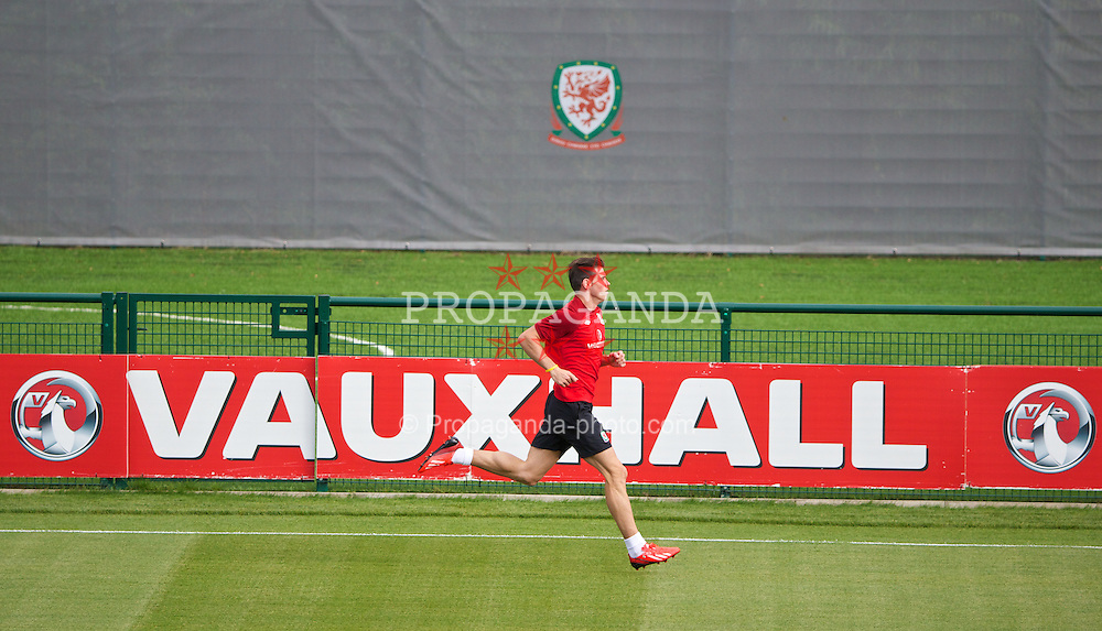 NEWPORT, WALES - Monday, August 12, 2013: Wales' Gareth Bale during training at the FAW National Development Centre at Dragon Park ahead of the International friendly against the Republic of Ireland. (Pic by David Rawcliffe/Propaganda)